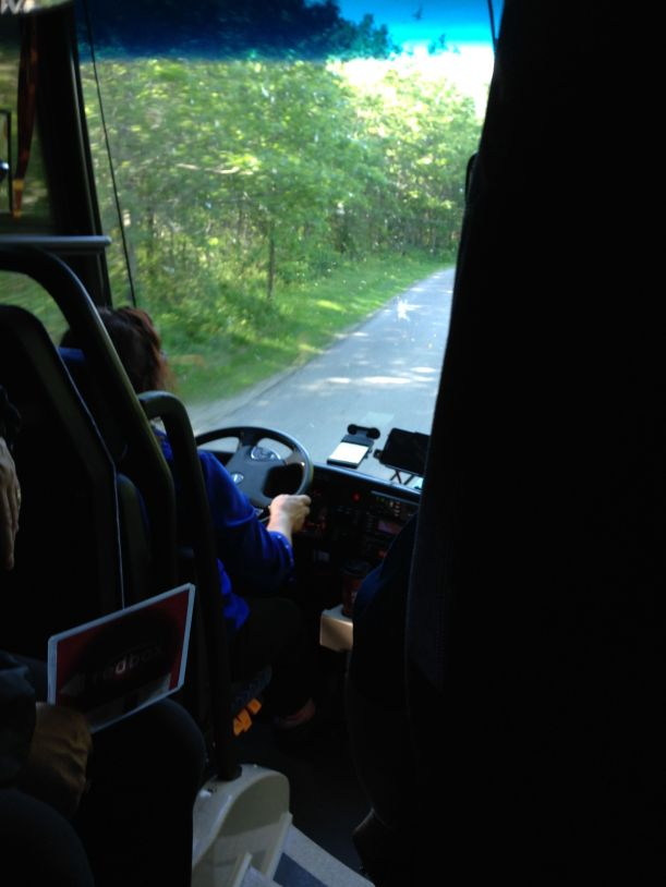 A staff member rides along behind the driver to manage kids and paperwork