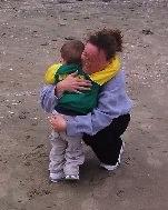 Woman hugs child