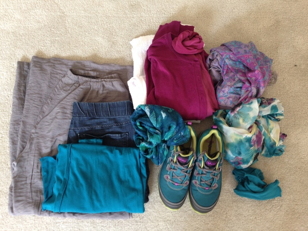 Folded clothes; note the 2nd scarf added in the center