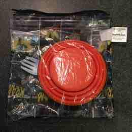Bumkins snack bag (large size) with Ziploc sandwich bag (holding orange round & spork)