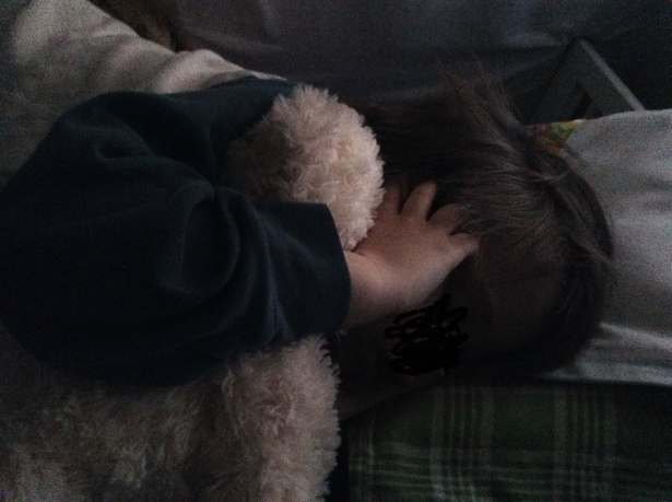 sleeping child in dim