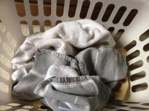 towels in laundry basket - 1