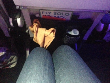 "Coach legroom= 1"" from seatback"