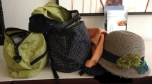 Tom Bihn PCSB and Cafe Bag with Sunday Afternoons hat on hotel desk