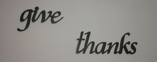 "Wall art stating ""Give thanks"""