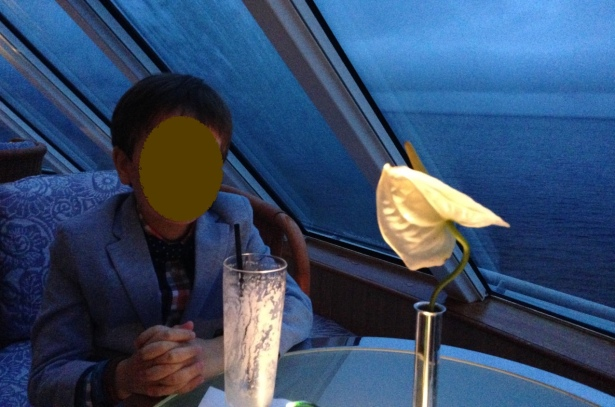 Son with mocktail in shipboard bar - 1