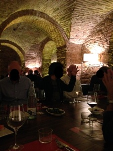 People seated in beneath stone arches in Barcelona restaurant
