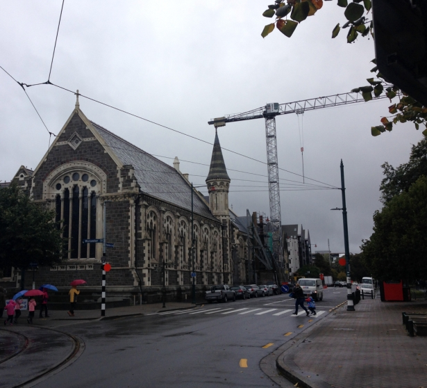 NZ Crane over stone building umbrellas