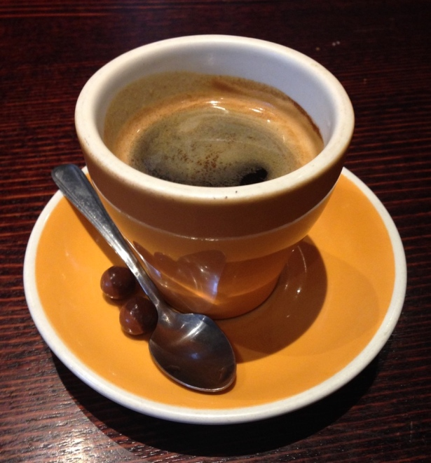 Espresso in demitasse cup on cafe table