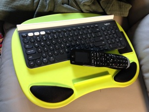 Bluetooth keyboard K780 Logitech on couch - 1