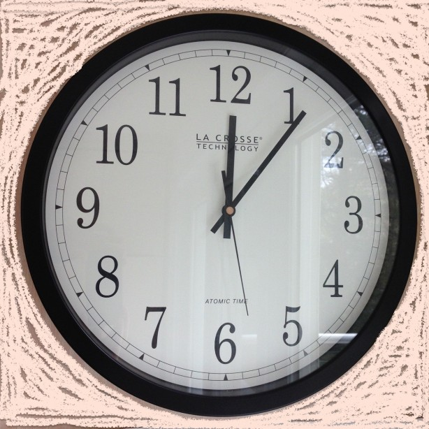 Analog wall clock showing 12:06