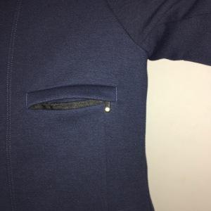 Chest pocket unzipped