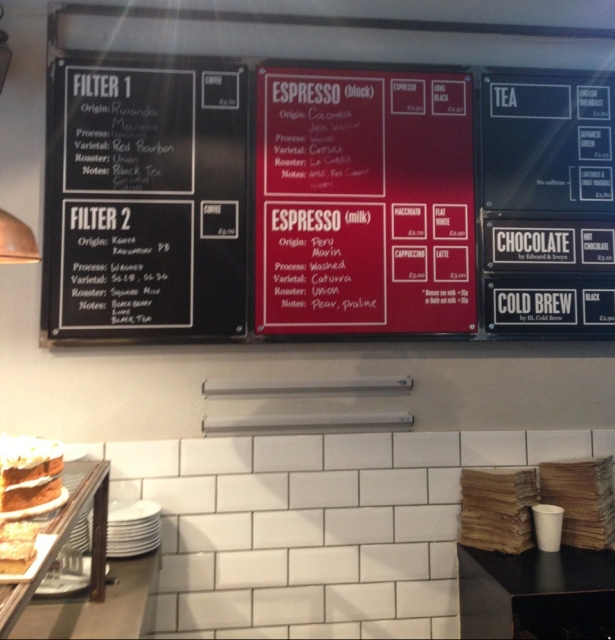 coffee shop menu board featuring espresso from Colombia and Peru