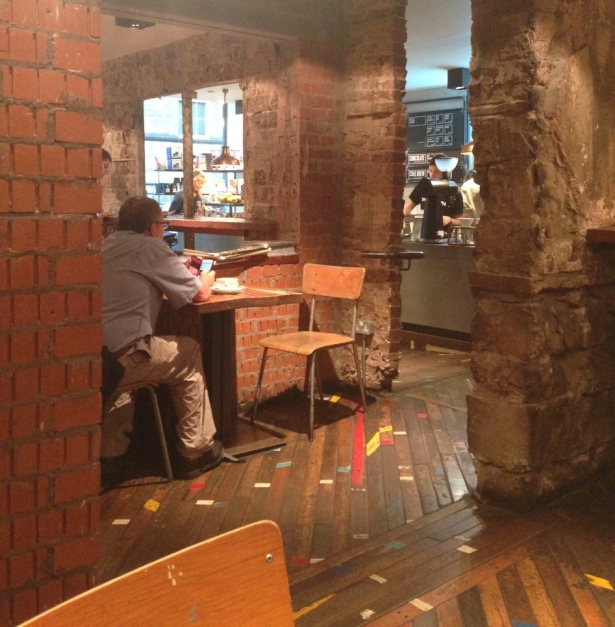 cafe interior made of old stone, brick, and reclaimed wood