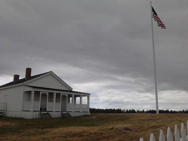 USA flag flying on pole WA San Juan American Camp