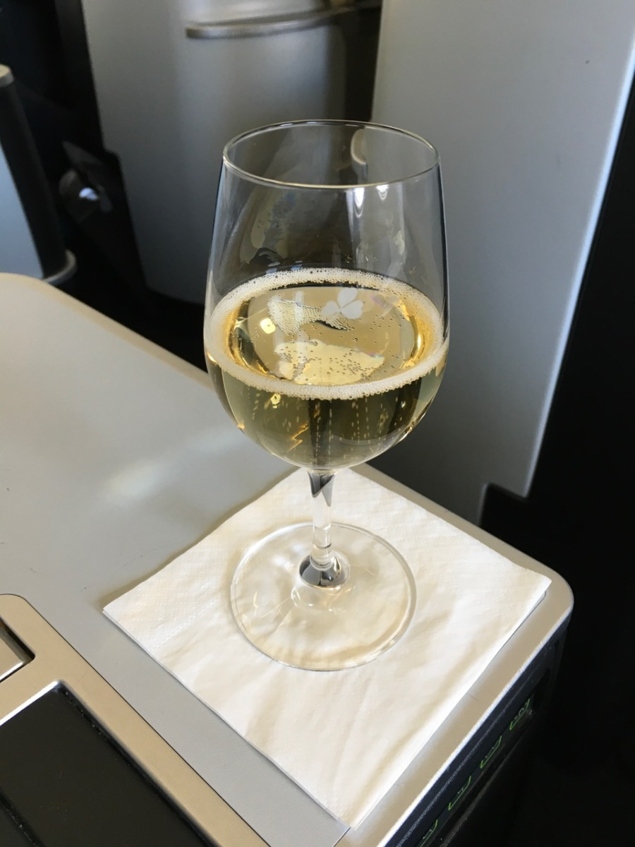 Aer Lingus sparkling wine in glass on Business Class tray table