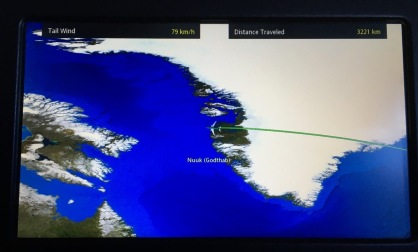 Airline in flight entertainment screen showing flight path on map over Nuuk, Greenland