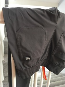 REI Mountainmaker trousers hanging to dry on railing