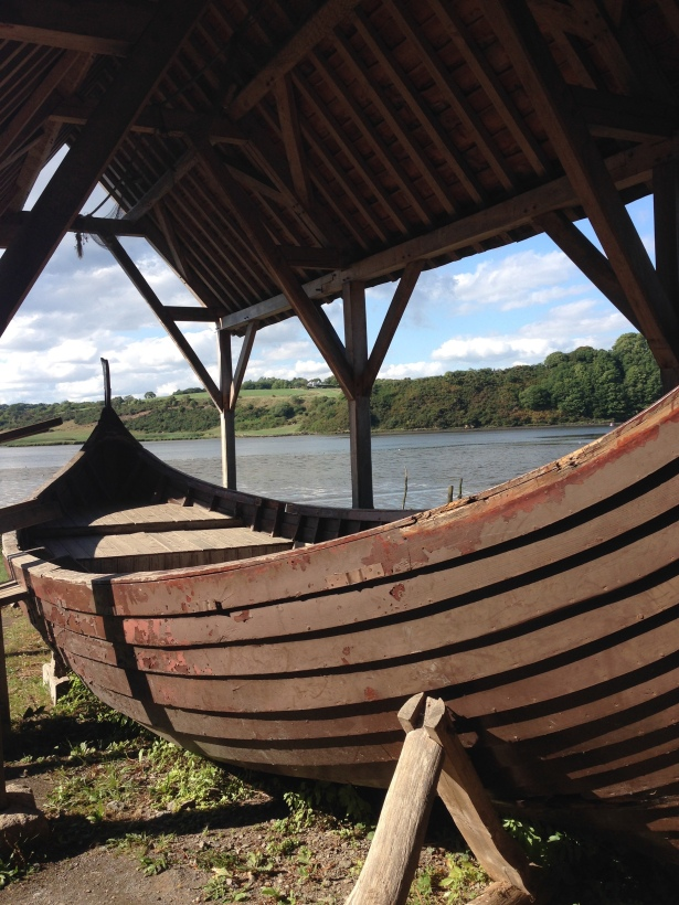 Viking style long boat beached alongside Irish lake