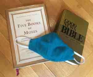 Jewish Torah, Good News Bible, and cloth face mask
