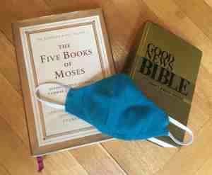 Jewish Torah, Good News Bible, and cloth face mask