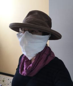 The author wearing an improvised home-made face covering