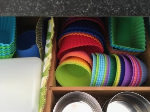 Several shapes of colorful silicone muffin cups stored in lunch packing drawer