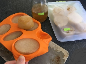 Mushroom broth frozen in silicone muffin tray and stored in baggie