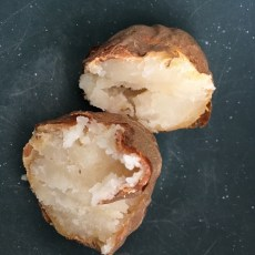 baked potato, cut open to show texture