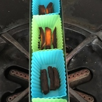 goSun Sport cooking tray filled with silicone cups of burned sweet potato fries
