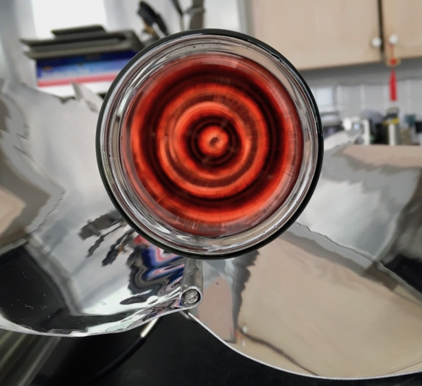 Mesmerizing red circle illusion inside goSun solar oven glass cooking tube