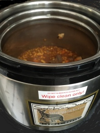 Thermal Cooker with stew-filled primary pot inserted, side view