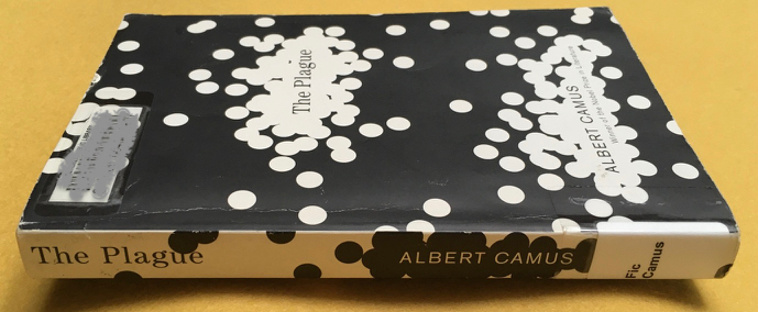 Library paperback copy of The Plague by Camus