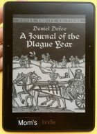 Kindle Voyage device displaying book cover Journal of the Plague Year by Defoe