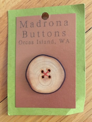 New Madrona wood button on display card