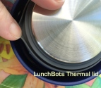Blue plastic LunchBots lid with interior lined with stainless steel and grey silicone gasket