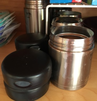 6 Thermos food jars in 2 sizes in cupboard, but only 4 lids