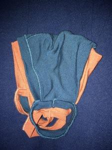 smaller blue mask layered over larger orange mask