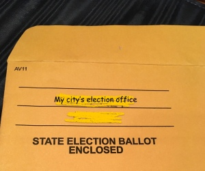 Mail in ballot envelope labeled State Election Ballot Enclosed