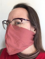 woman wearing loose fitting cloth face mask