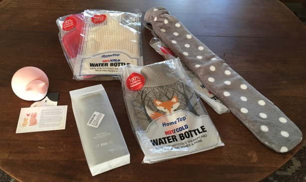6 new hot water bottles with their packaging