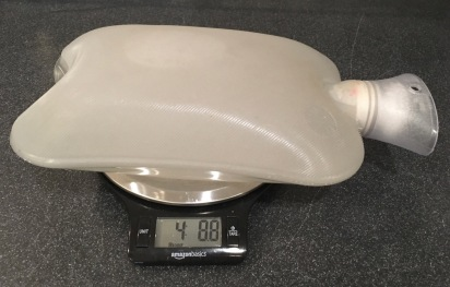 standard hot water bottle on scale showing 4 lb 8.8 oz