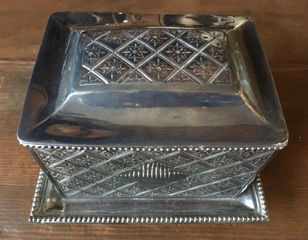 Silver box etched with floral ang geometric patterns