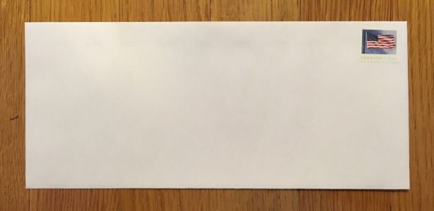 Number 10 (business size) envelope with stamp