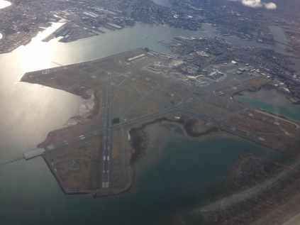 airport viewed from commercial plane window in the sky