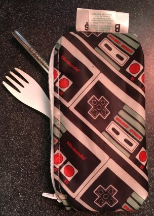 Bumkins zipper snack bag in Nintendo GameBoy print with white spork and stainless straw poking out