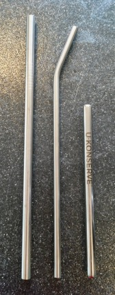 Three stainless steel straws, a long, straight one, an angled straw, and a shorter U-Konserve Mini straw about 2/3 the length of the others