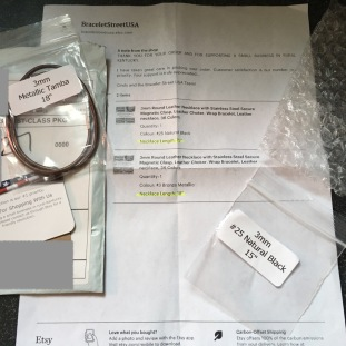Necklace alongside invoice alongside simple yet adequate packaging from Bracelet Street USA