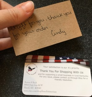 Handwritten note of thanks from Cindy next to Bracelet Street business card