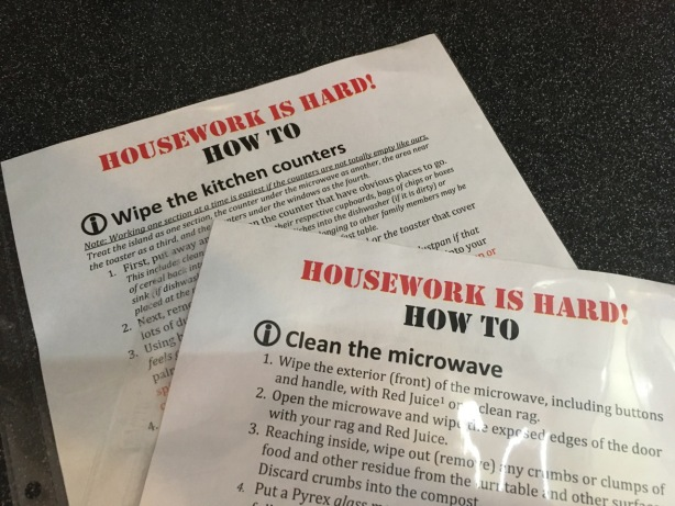 Printed instructions titled Housework is Hard! describing how to wipe kitchen counters and clean the microwave